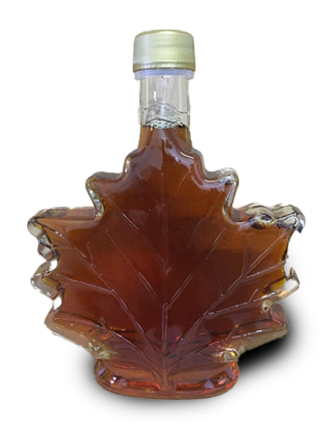 Maple leaf shaped glass bottle of maple syrup